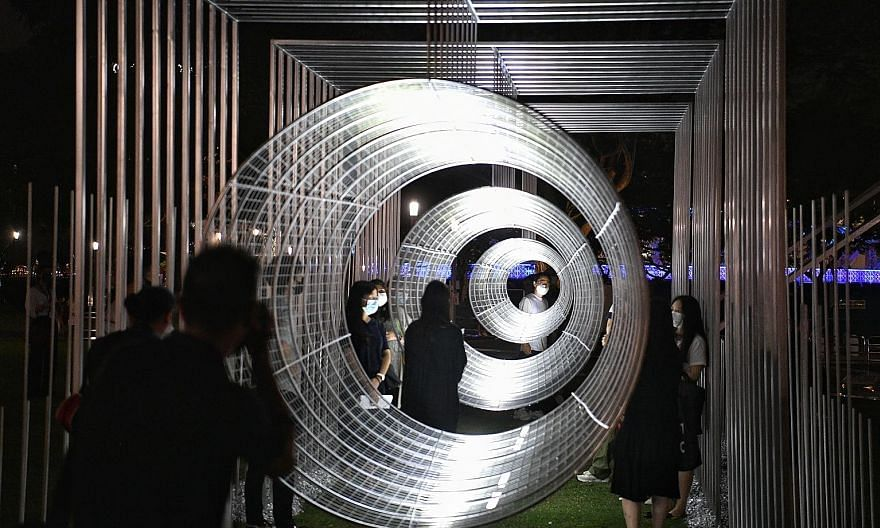 People enjoying a new perspective on things through this giant telescope on the Asian Civilisations Museum Green yesterday. Ways Of Seeing was produced by architecture studio Zarch Collaboratives and is one of the highlights of this year's Light to N