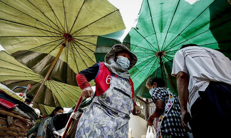 A wet market in the Thai capital Bangkok. Investment managers see emerging market equities, which have been under pressure during the pandemic-hit 2020, picking up strongly this year. This includes most South-east Asian and East Asian markets, which