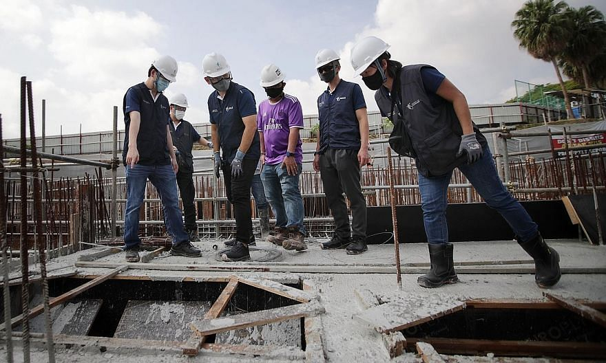 Senior Minister of State for Manpower Zaqy Mohamad (front, second from left), together with safety inspectors from the Ministry of Manpower's occupational safety and health division, inspecting the worksite of Affinity at Serangoon condominium yester