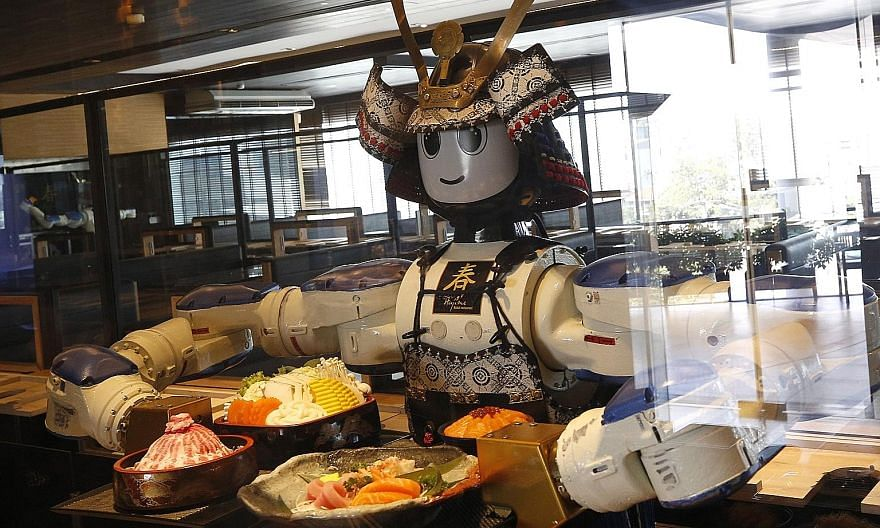 A robot serving customers earlier this month at Hajime Robot Restaurant, a Japanese eatery in Bangkok. As robots play a greater role in society, we will need to adapt our laws to accommodate them. As long as there is transparency and we maintain huma