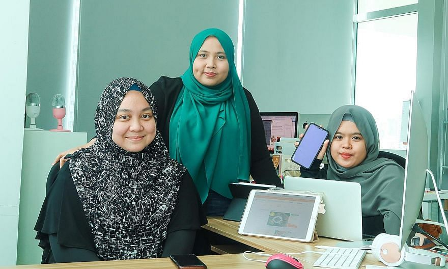 Halalfoodhunt chief executive and co-founder Jumaiyah Mahathir (centre), 31, flanked by managing assistant Nur Sarah Razali (far left), 24, and sales executive Nur'Adriana Maisarah Abdul Rani, 21, at their office in Jalan Besar. In 2019, the company