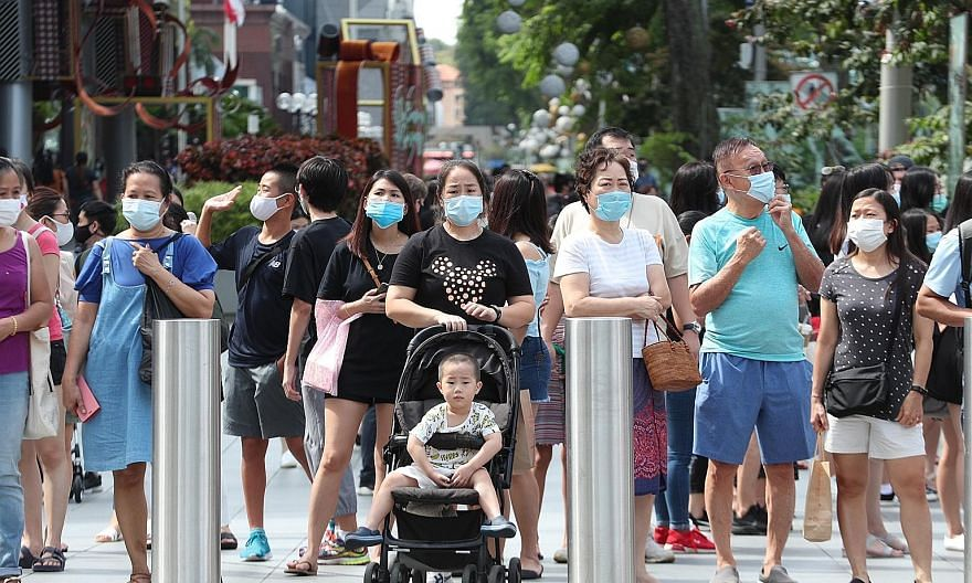 Wearing masks outdoors (above) and observing safe distancing (left) are among the practices that many Singapore residents will keep to when the Covid-19 pandemic is over, according to a nationwide online study conducted last month by Nanyang Technolo