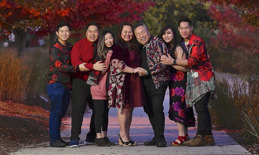 The Lai family all dressed up for Chinese New Year in Ontario, Canada, where they live. From left: Joel, 24; Ryan, 28, with his wife Jaime, 28; Mrs Marianne Lai and her husband David, both 60; Desiree, 21; and Justin, 26.