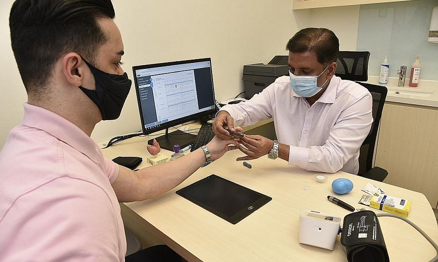 Endocrinologist Nitish Mishra shows how a glucometer strip test check on a diabetic patient is done.