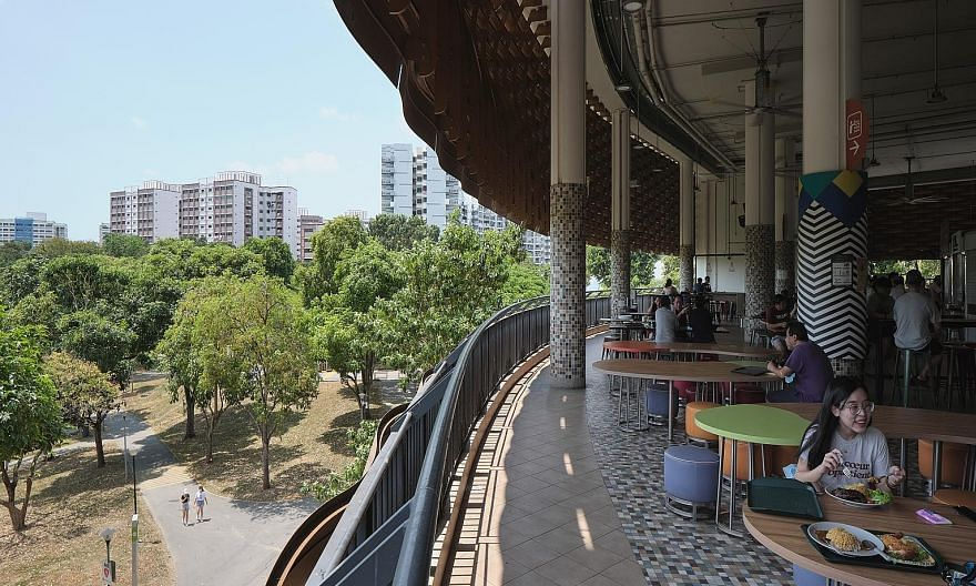 The architectural features captured by the photography series range from Tampines Round Market and Food Centre's circular roof to Pasir Ris Hawker Centre's wave-like metal facade (above). PHOTO: FABIAN ONG