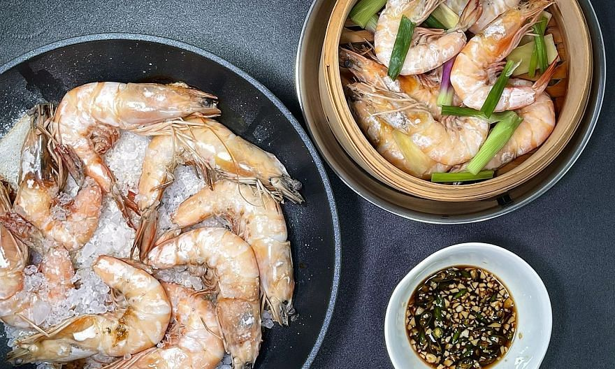 Salt-baked prawns (far left) and steamed prawns with dipping sauce.