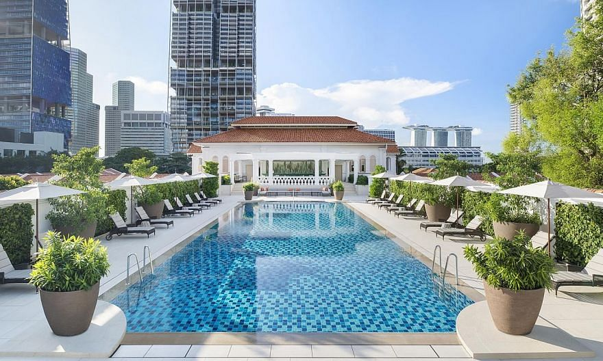 DayAway, a booking platform specialising in luxury hotel experiences, worked with Raffles Hotel Singapore to create the Sunrise Spa and Swim package, which includes two hours at the pool (top). The hotel's afternoon tea (above) was also popular durin