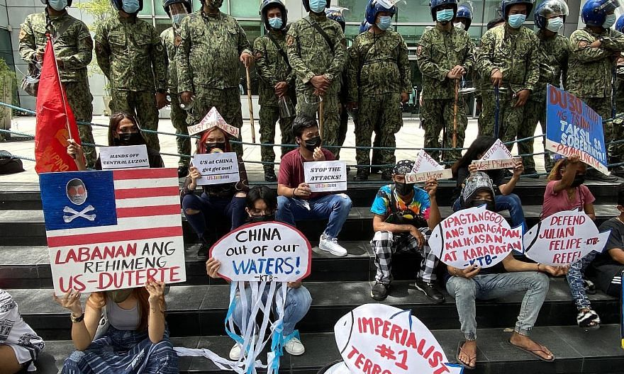 Filipino protesters outside the Chinese consular office in Manila yesterday, the fifth anniversary of an international tribunal ruling rejecting much of Beijing's claim to the South China Sea.