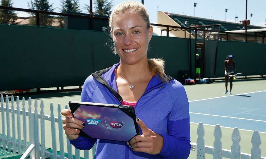 Angelique Kerber of Germany, who beat Russian Daria Gavrilova 6-1, 6-3 in the first round of the Stanford Classic, using a tablet with live match data at a SAP press conference yesterday.