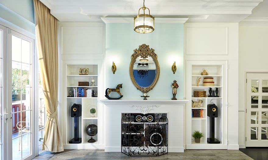 (Clockwise from above left) The owner's black recliner is a contrast to the other white furniture in the living room; the common bathroom; and Ms Felicia Gan in her open-plan kitchen. Shelving (left) on the feature wall in the living room conceals an
