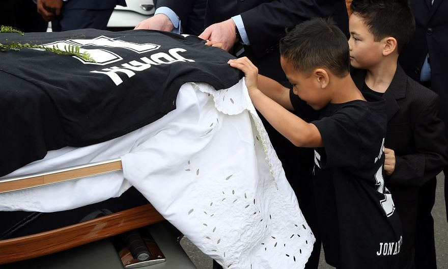 Brayley (right) and Dhyreille (left), sons of the late All Blacks legend Jonah Lomu, help load their father's casket into a hearse following a funeral service on Dec 1. Lomu died aged just 40 on Nov 18.