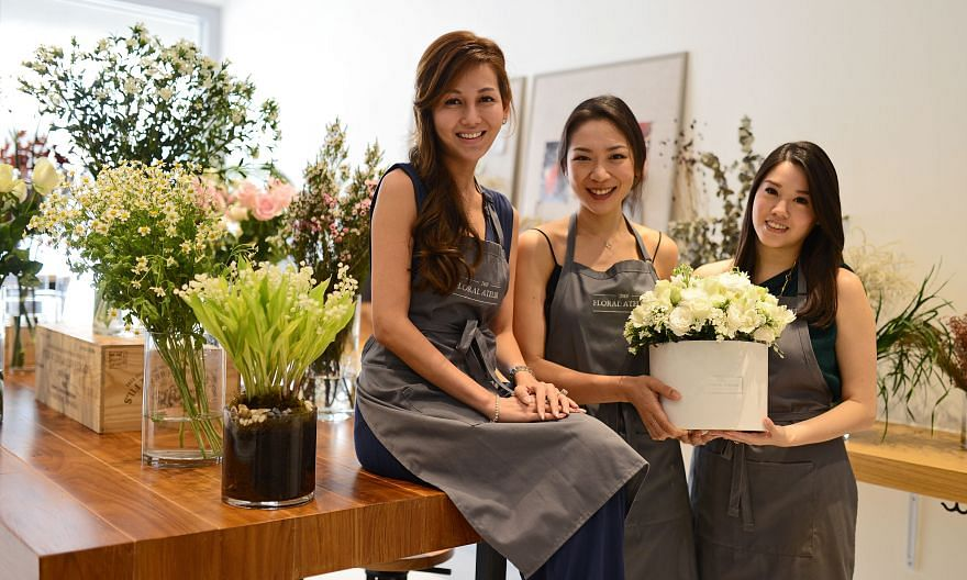 Mrs Fiona Treadwell uses succulents, herbs and fruit in her arrangements. Old-timer Floral Magic is now helmed by two generations and has gone the indie route. (From left) Ms Patricia Low, Ms Joanna Teo, Ms Linnette Lau, Ms Josephine Lau and Ms Lucy