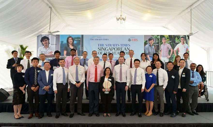 At the ST Singaporean of the Year award ceremony yesterday were (back row, from left) Kiss92 senior presenter Arnold Gay; finalist community volunteer Ang Thiam Hock; Mr Freddie Ang, father of finalist conductor Darrell Ang; finalists charity founder