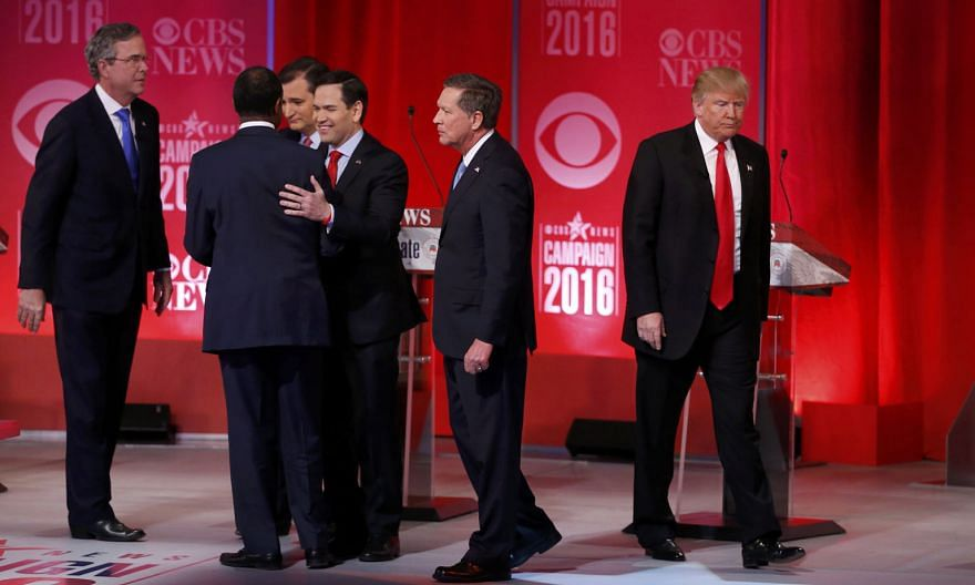 Mr Trump (far right) walking off the stage as his rivals (from left) Mr Bush, Dr Carson, Mr Cruz, Mr Rubio and Mr Kasich gather at the conclusion of the debate in Greenville, South Carolina, on Saturday. The showdown featured some of the Republican p