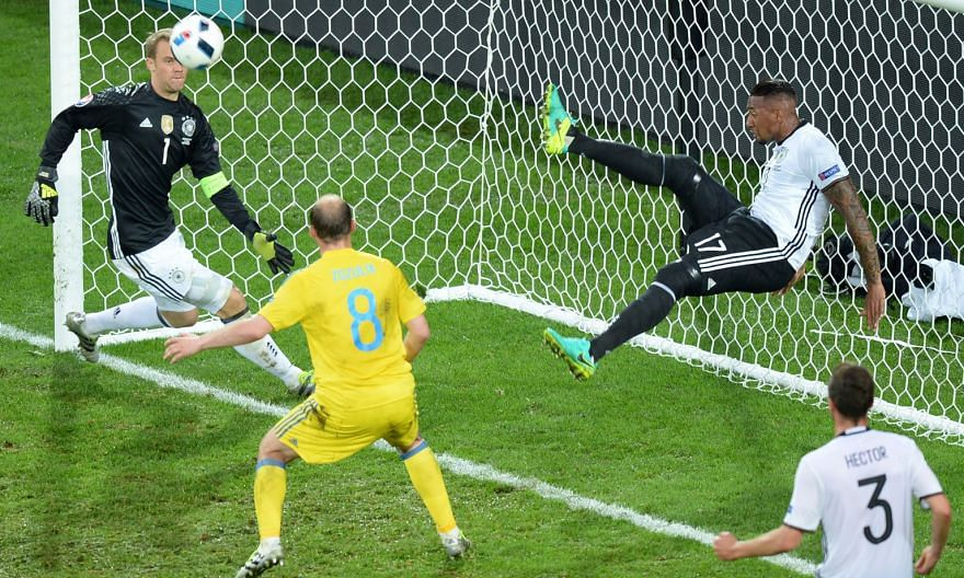 Germany defender Jerome Boateng's goal-line clearance prevents Ukraine from equalising, with goalkeeper Manuel Neuer well beaten, during their Group C game.