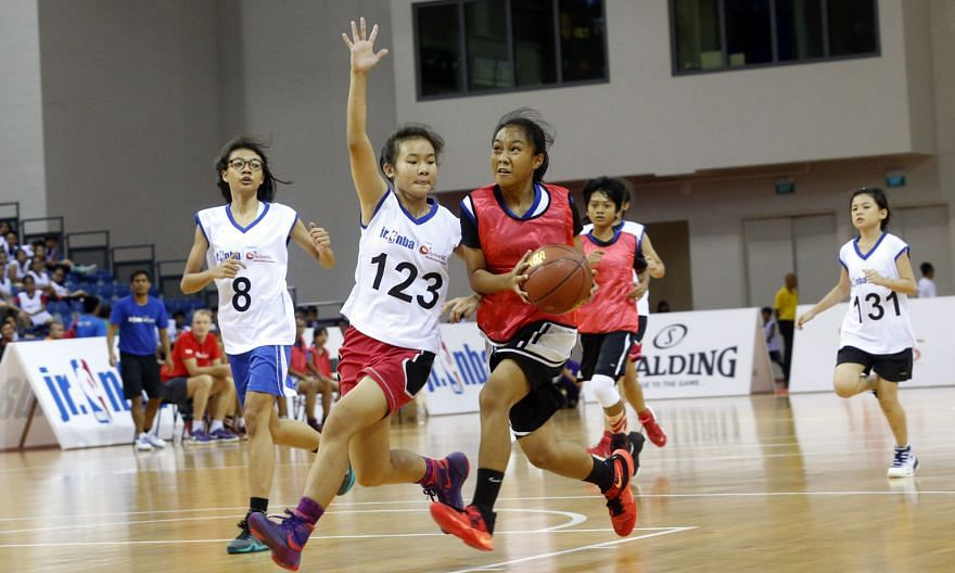 Jurong Secondary School's Valarie Lim (No. 123) showing the defensive side of her game. The 14-year-old was named girls' Most Valuable Player at the first Jr. NBA Singapore 2016 National Training Camp.
