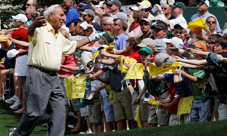 "Arnold Palmer approaching his fans during the Par 3 contest before the 2010 Masters. He went to great lengths to ensure every member of ""Arnie's Army"" went home with an autograph."