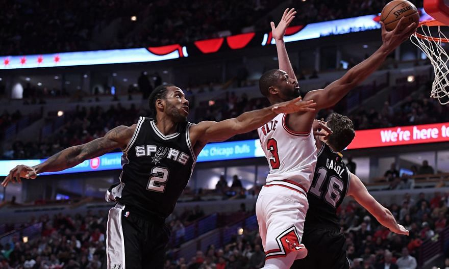 Chicago Bulls guard Dwyane Wade going up for a basket, as San Antonio Spurs forward Kawhi Leonard and centre Pau Gasol fail to block him during the second half at United Centre. Chicago defeated San Antonio 95-91, falling one game short of tying Gold