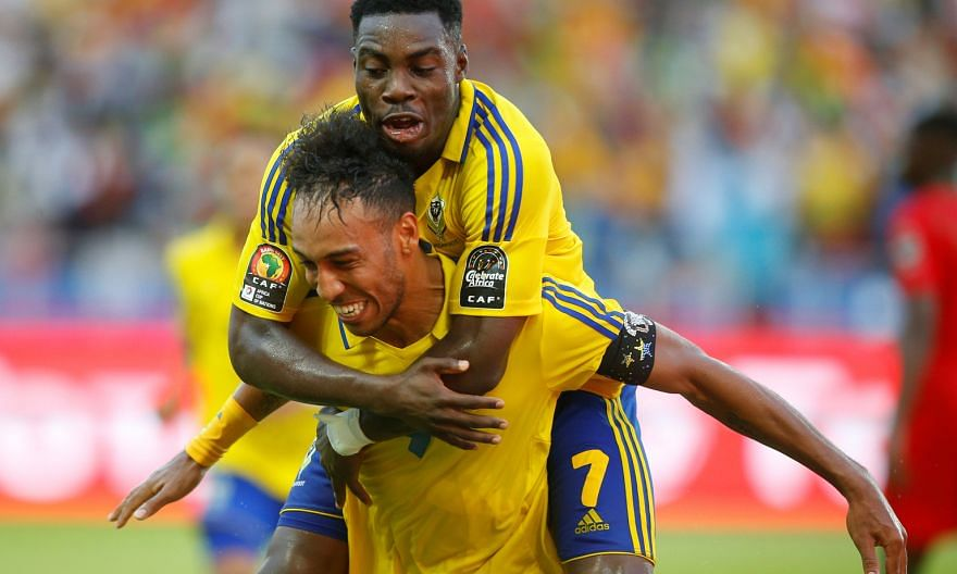Gabon star Pierre-Emerick Aubameyang celebrates scoring against Guinea-Bissau with fellow forward Malick Evouna.