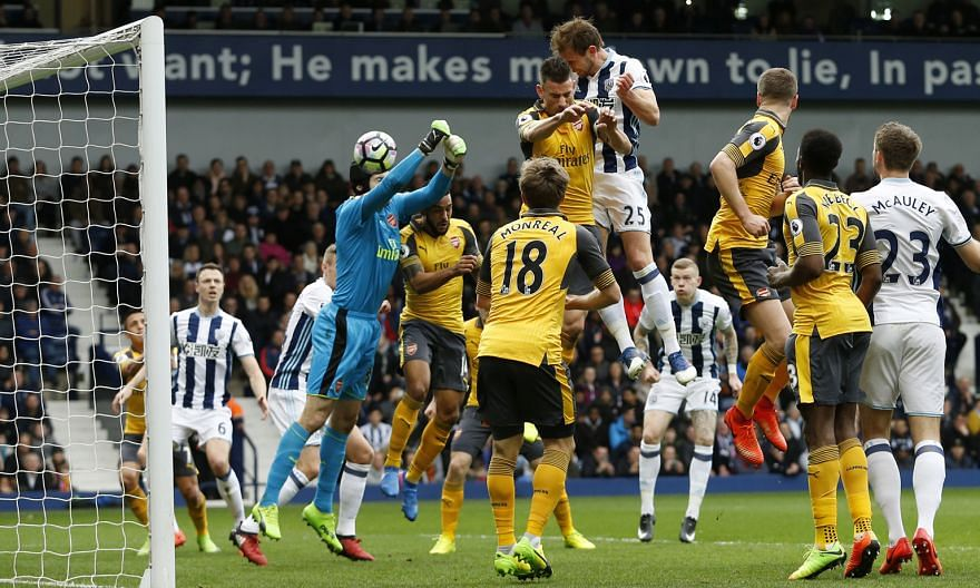 Craig Dawson heading in to give West Brom the lead against Arsenal. He wrapped up the 3-1 win with another header late in the game. The Gunners stay five points behind Liverpool in the battle for the final Champions League spot.