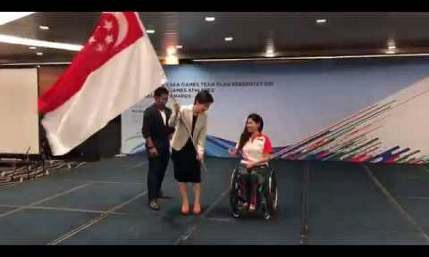 Yip Pin Xiu receiving the Singapore flag for the Asian Youth Para Games