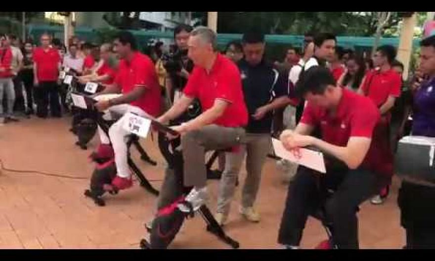 PM Lee cycling with residents during a charity cycling challenge