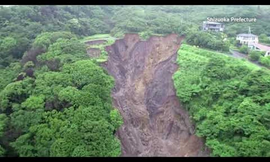 Japan's landslide rescue, with about 80 missing