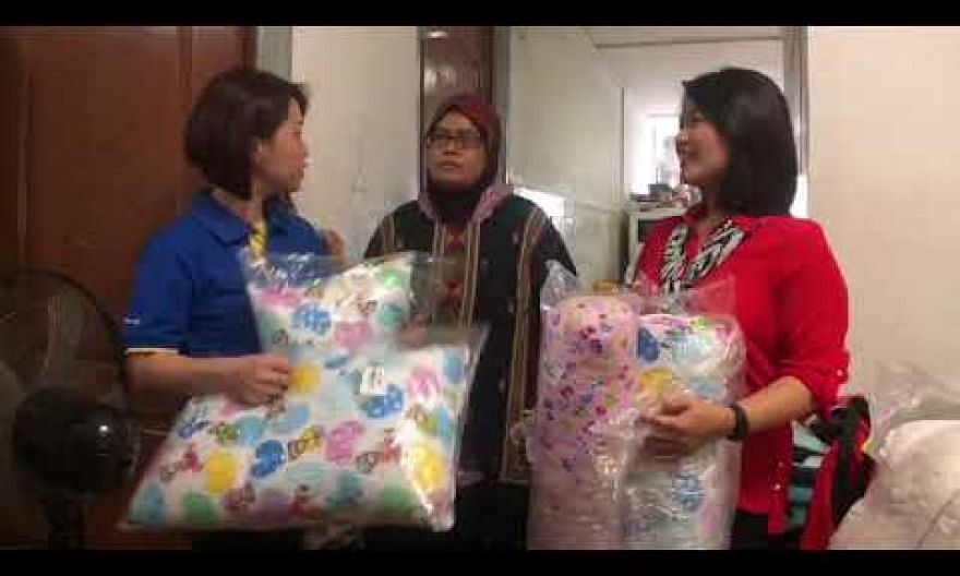 Madam Siti Norbayah's family receive a stove, wardrobe, fridge and other items