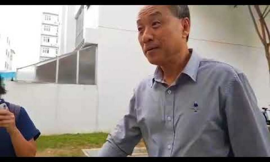 WP chief Low Thia Khiang speaks to reporters as he arrives at party HQ
