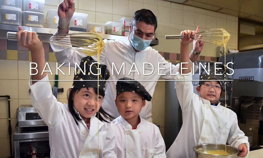 Kids baking madeleines with executive chef Thibault Chiumenti of The St. Regis Singapore