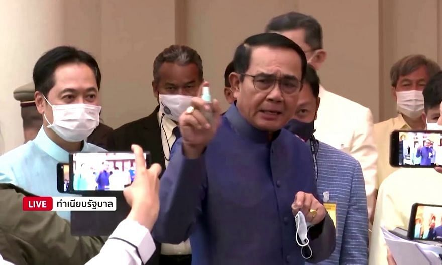 Thai PM sprays sanitiser on journalists to avoid questions