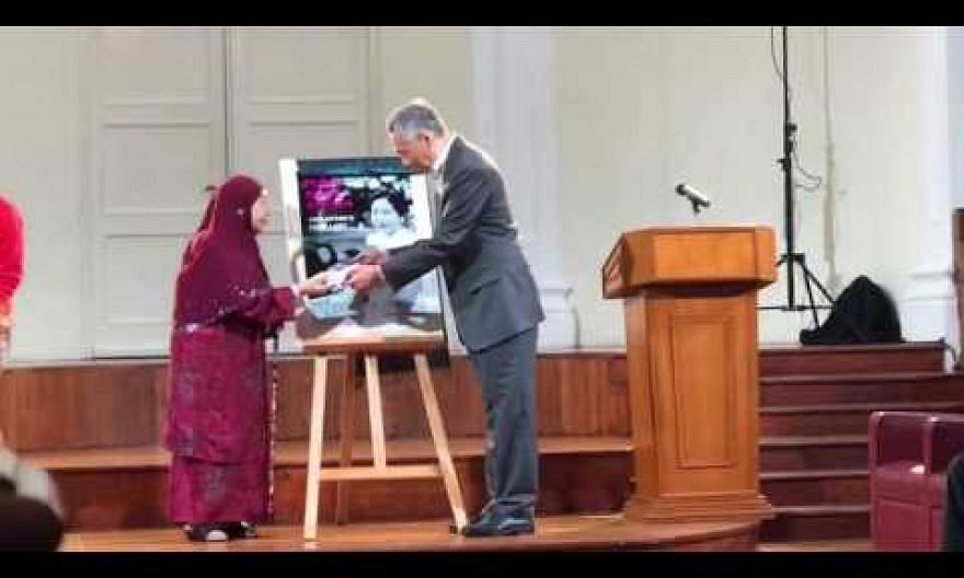 PM Lee launches a new book on Puan Noor Aishah's life