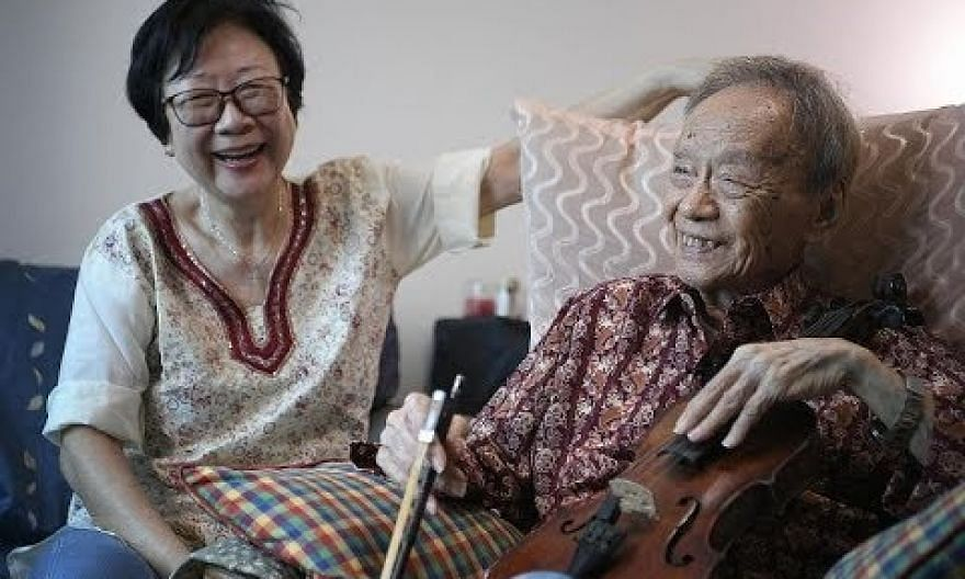 Julai Tan, 93, the oldest performer at this year's National Day Parade shows off his violin skills