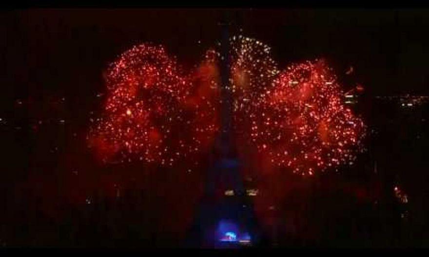 Fireworks illuminate Eiffel Tower for Bastille Day