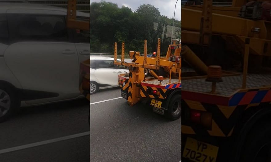 Accident involving trailer, private bus and motorcycle along BKE