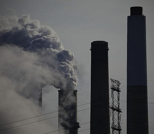 Left: Emissions from a power generating plant in Ghent, Kentucky. Bloomberg reports that the Biden administration is considering pledging to cut emissions in the US by around 50 per cent below 2005 levels by 2030. PHOTO: BLOOMBERG Below: An aerial vi