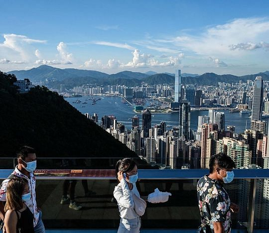 Visitors on Victoria Peak in Hong Kong last July. Those using the travel bubble must test negative for Covid-19 in a polymerase chain reaction (PCR) test taken within 72 hours before their flight.