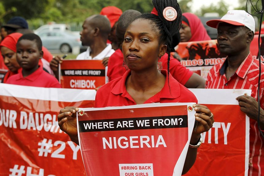 Members of the Bring Back Our Girls campaign taking part in a rally on the second anniversary of the abduction of the Chibok school girls by Boko Haram, in Abuja, Nigeria, on April 14, 2016.