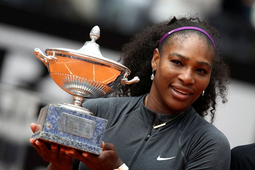 Serena Williams poses with the trophy after defeating Madison Keys in their women's final of the Italian Open tennis tournament at the Foro Italico in Rome on May 15, 2016.
