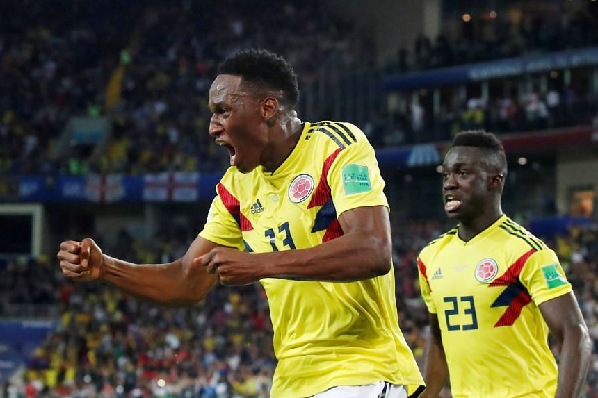Colombia's Yerry Mina celebrates a goal during the 2018 World Cup.