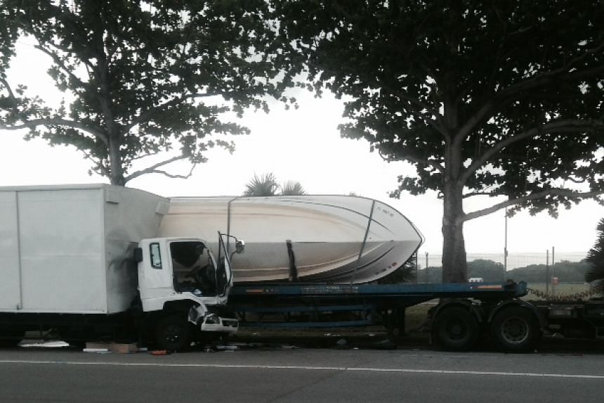 The scene of the accident, after the delivery truck crashed into a stationary prime mover that was carrying a boat, on April 28, 2015.