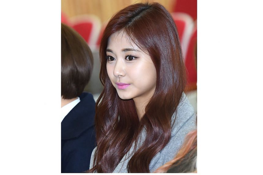 JYP Entertainment Corp said that they did not force Chou Tzu-yu (above) to apologise for holding Taiwanese flag.