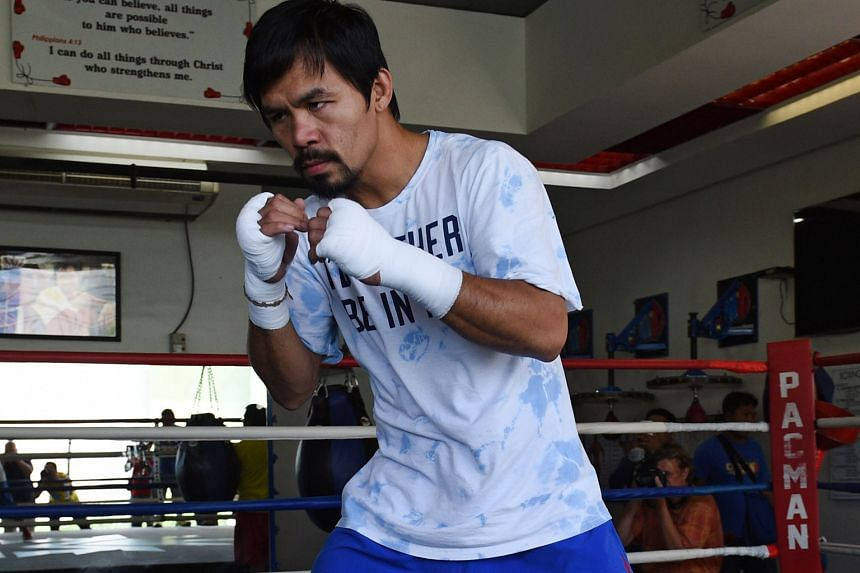 Father Jerome Secillano says that Pacquiao (above) was only quoting the Bible against gay marriage, but also agrees that the boxer should not have used offensive language.