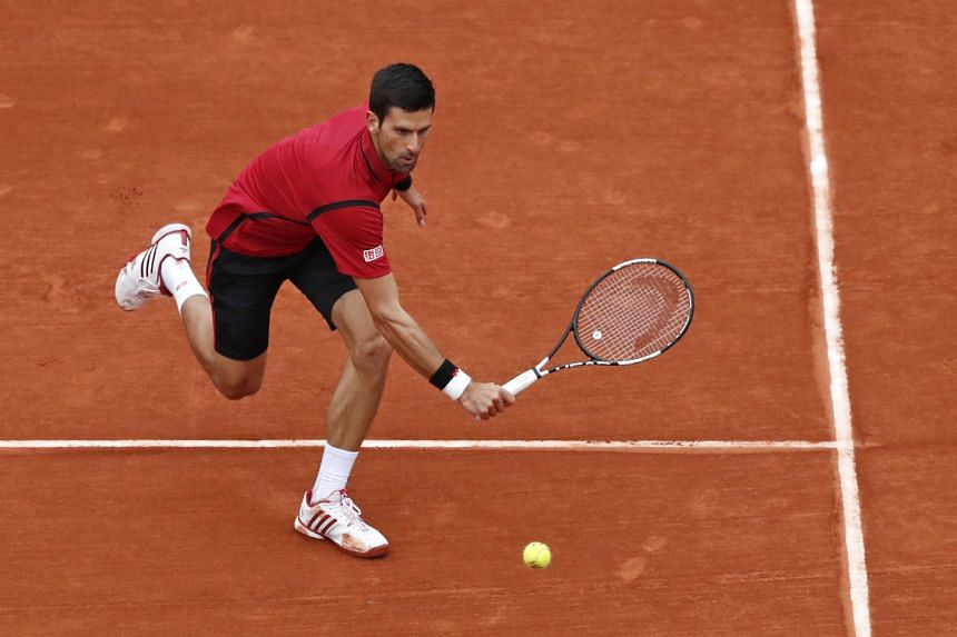 Novak Djokovic returns the ball during his match against Tomas Berdych during the French Open Men's Singles quarter-final on June 2, 2016.