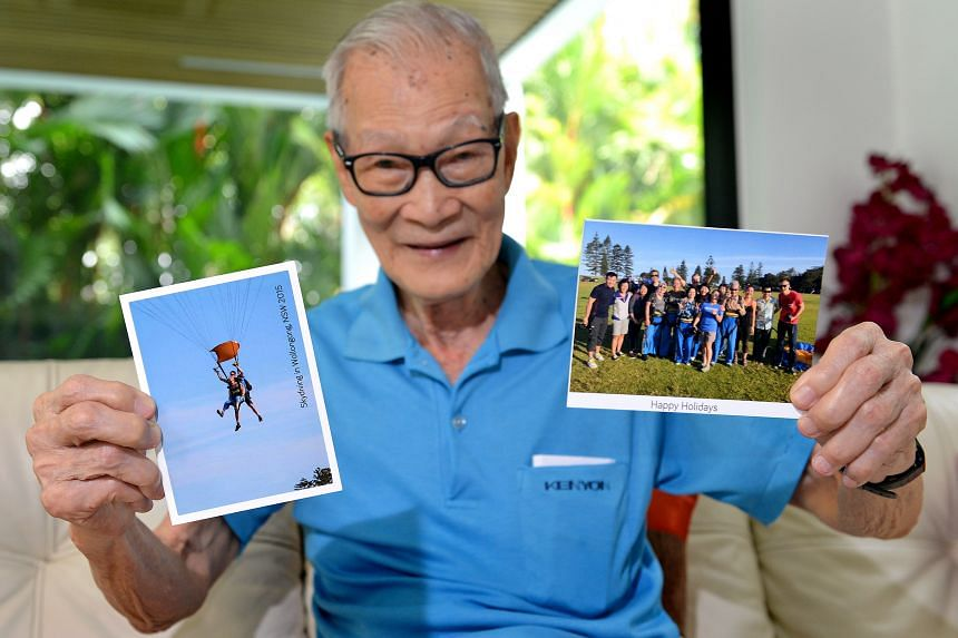 Mr Tan Kok Sing sharing photos of the skydive, which he did with 13 family members.