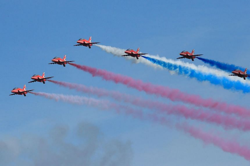 A performance by the Red Arrows, the aerobatic team of Britain's Royal Air Force.