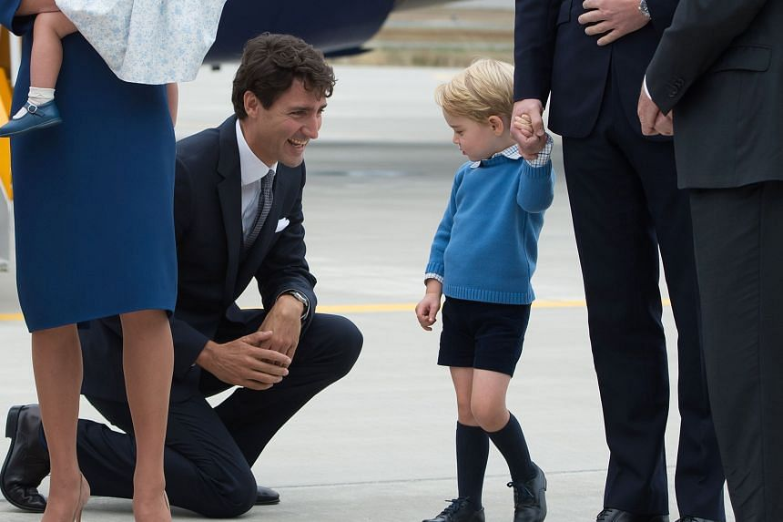 Canadian Prime Minister Justin Trudeau kneeling to talk to Prince George.