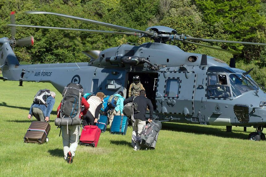 A photo taken on Nov 15, 2016, shows a New Zealand Defence Force helicopter landing at Woodend after evacuating around 1,200 of tourists from Kaikoura.