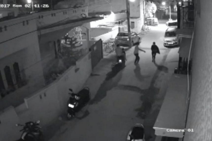 A screen-grab of the video clip of the attack by two men as the woman walked down a secluded lane in a residential area in Bengaluru, India on Dec 31, 2016.