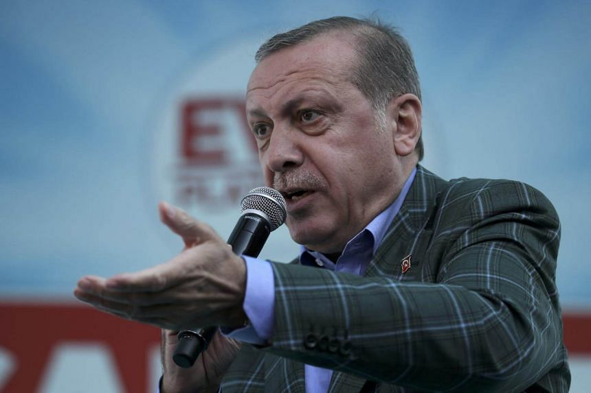 Turkish President Tayyip Erdogan addresses his supporters during a rally for the upcoming referendum in Istanbul, Turkey, on April 15, 2017.